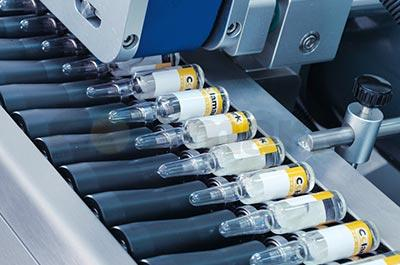 High Speed Horizontal Labeling and Tray Insertion Solution